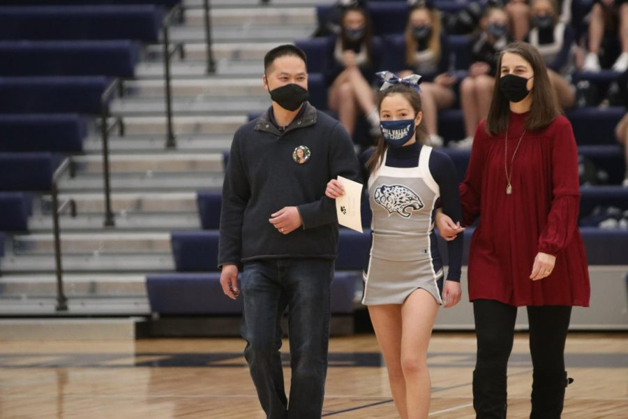 Senior Allison Pham walks out after her name is announced.