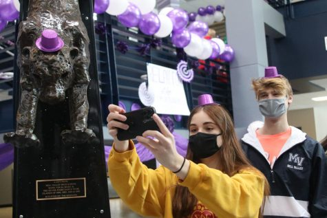 Taking a selfie, Senior Ellie Boone and junior Bret Weber smile at the camera under their masks at the Relay for Life purple bomb on Monday, Jan. 25.