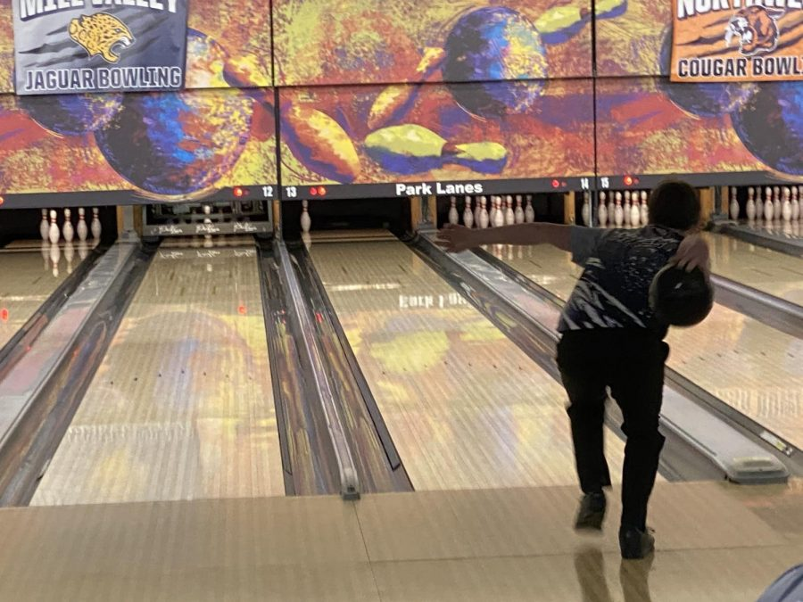 Getting ready to throw the ball, freshman Andrew Kouris aims the ball for the last pin to secure a spare.