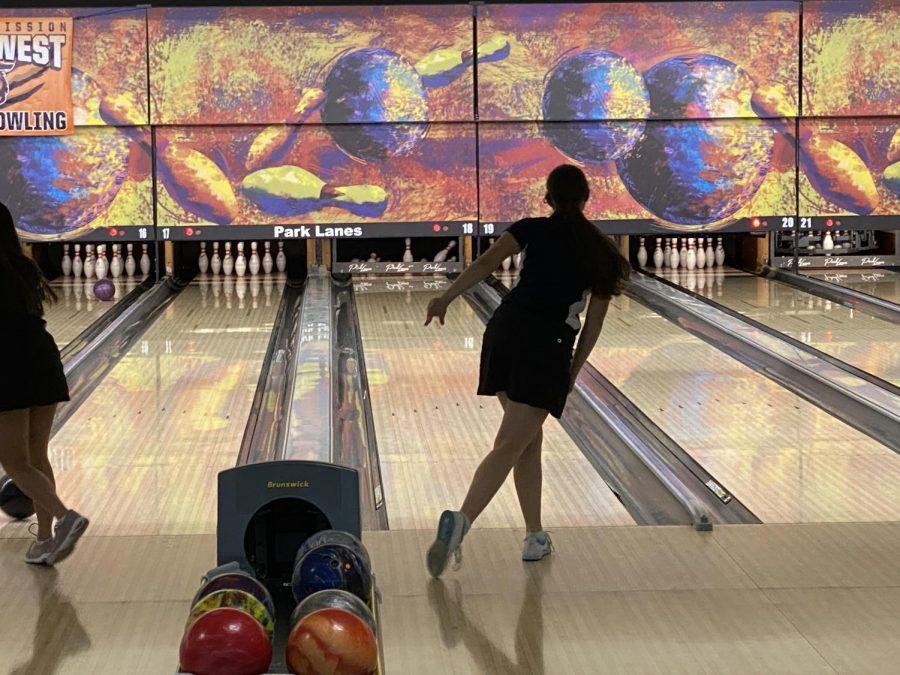 Releasing the ball down the lane, Kiara Gonzalez bowls a perfect strike.