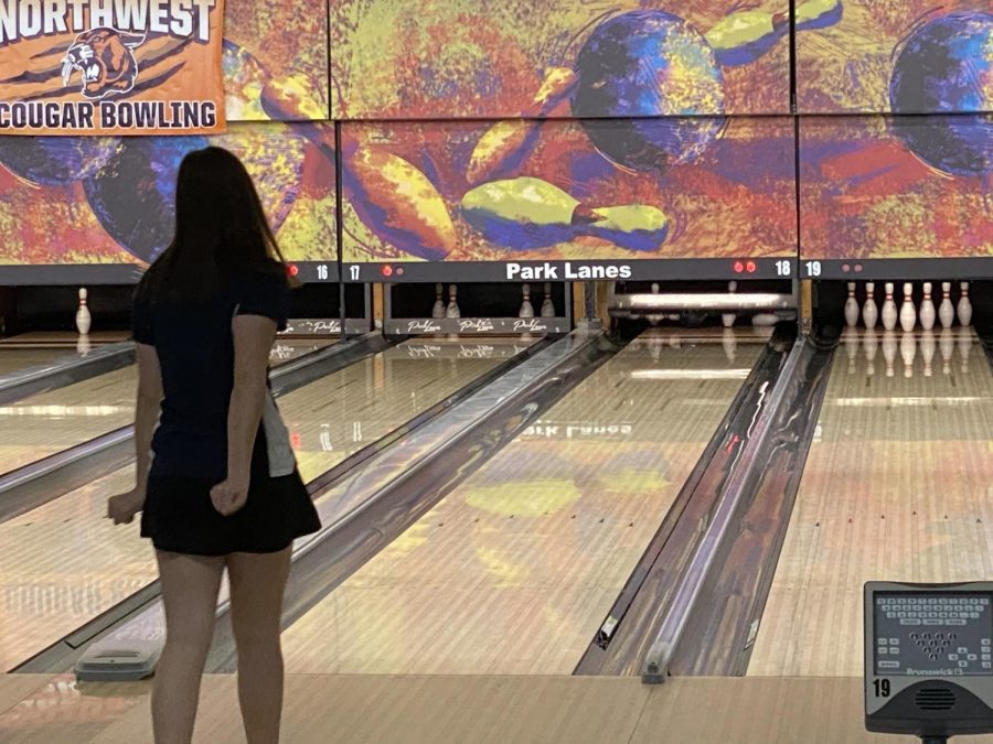 Waiting in anticipation, senior Sophie Hannam successfully bowls a strike.