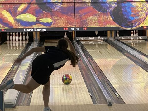 Still mid throw, freshman Kiara Gonzalez has to aim the ball at the single pin for the spare at the tournament on Tuesday, Jan. 26..