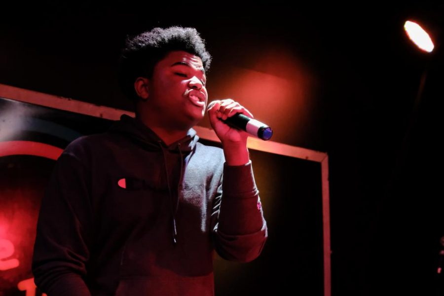 Rapping into the microphone on stage, junior Drew Morgan, also known as Lil Paula, performs at The Roxy in January of 2020.