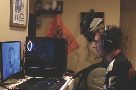 Using a pre-bought gaming computer build, senior John Scarpa drives through a practice mode to improve his advanced movement.