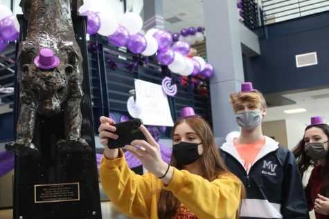 Taking a selfie, senior Ellie Boone and junior Bret Weber smile under their masks during the Relay for Life purple bomb on Monday, Jan. 25. As student body president, Boone has spent the year brining students together in new ways during COVID-19, like assisting with the RFL purple bomb.