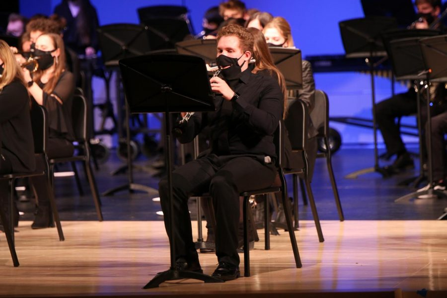 After a brief intermission for concert band take the stage, senior Seth Jeanneret plays the oboe.