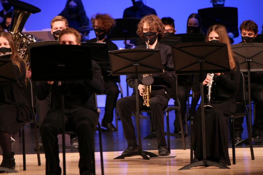 Playing the saxophone, sophomore Sean Olin focuses on the music.