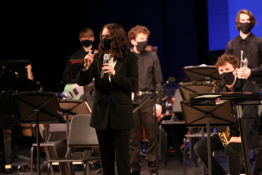Assistant band director Renee Huey explains the meaning behind the next song before the concert band performs.