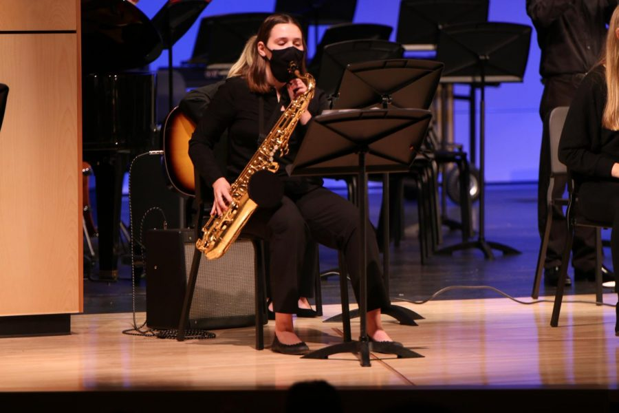 Holding her tenor saxophone, junior Abby Hayes plays with the jazz band.