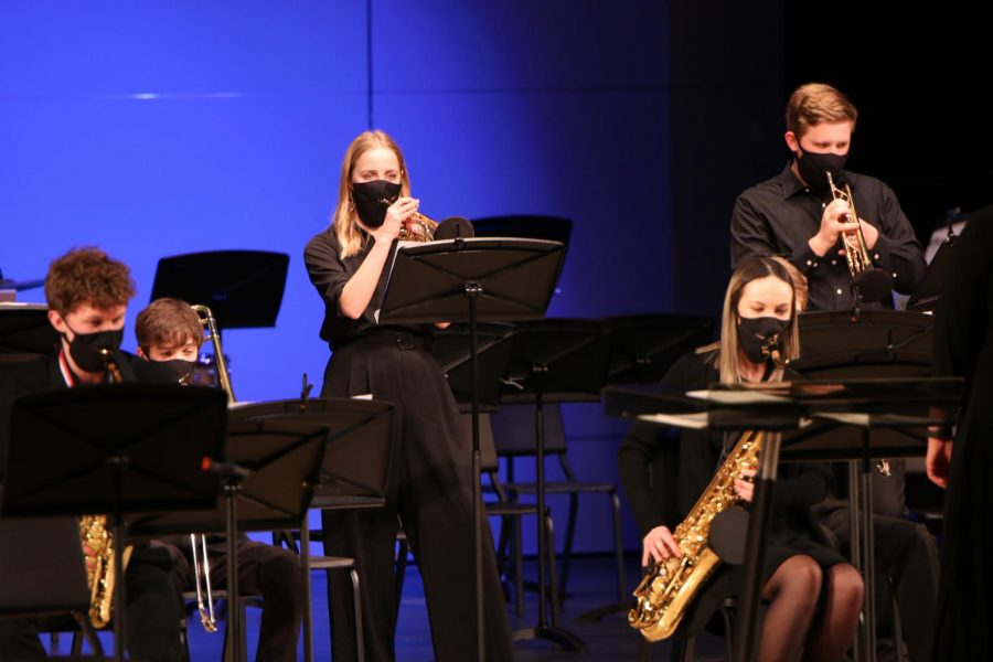 Standing to read the music, senior Molly Smith plays the trumpet with the jazz band.