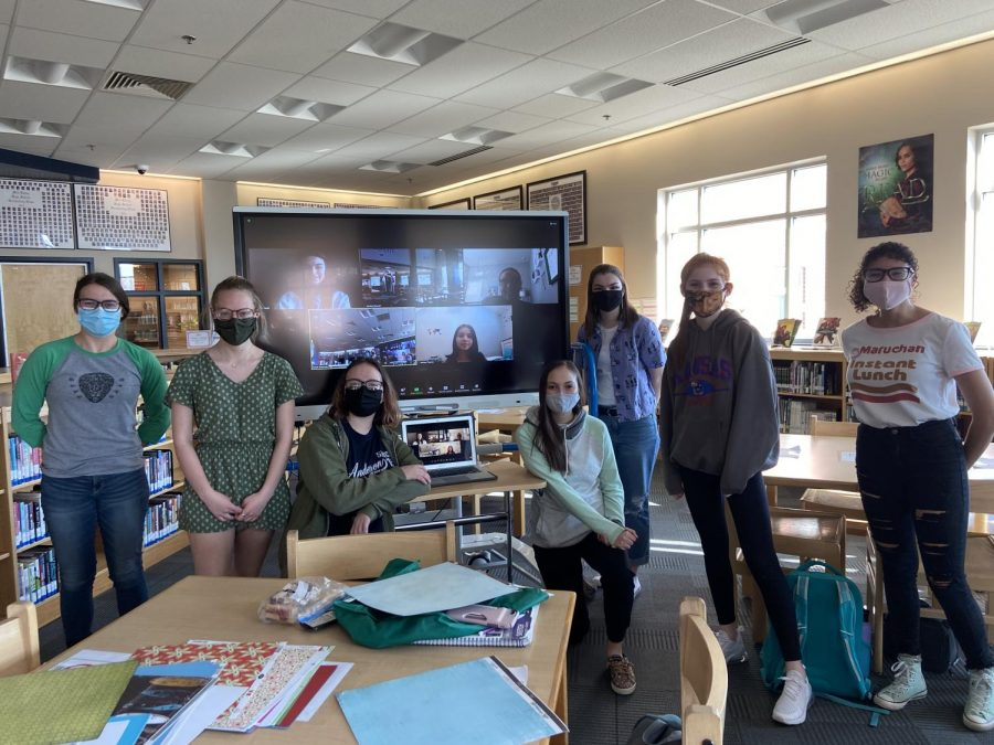 Members from the book club Project LIT pose for a photo. Their group encompasses even those that are remote. Outreach to Monticello Trails Middle School will allow new and younger students to join in reading the book The Wild Robot.