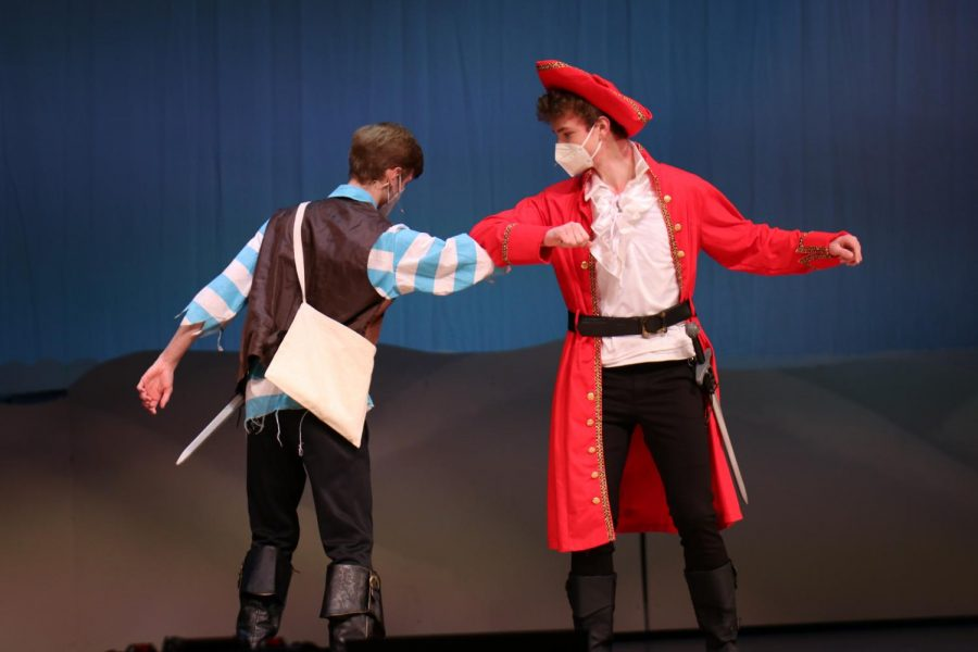 """Due to COVID-19, senior Leif Campbell and sophomore Finn Campbell decide to """"shake"""" elbows rather than to shake hands."""