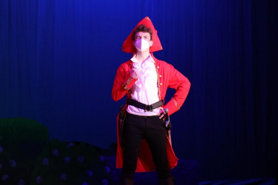 Sophomore Finn Campbell belts out one of the many songs while playing as his role of The Pirate King.