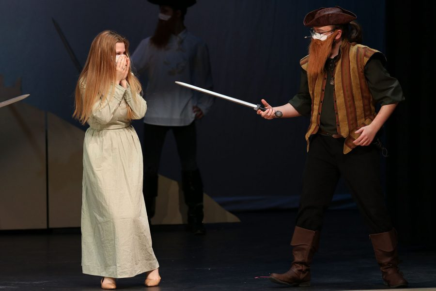 Dressed in a pirate costume, freshman Aiden Ferguson holds a sword out towards sophomore McKenzie Keltner.