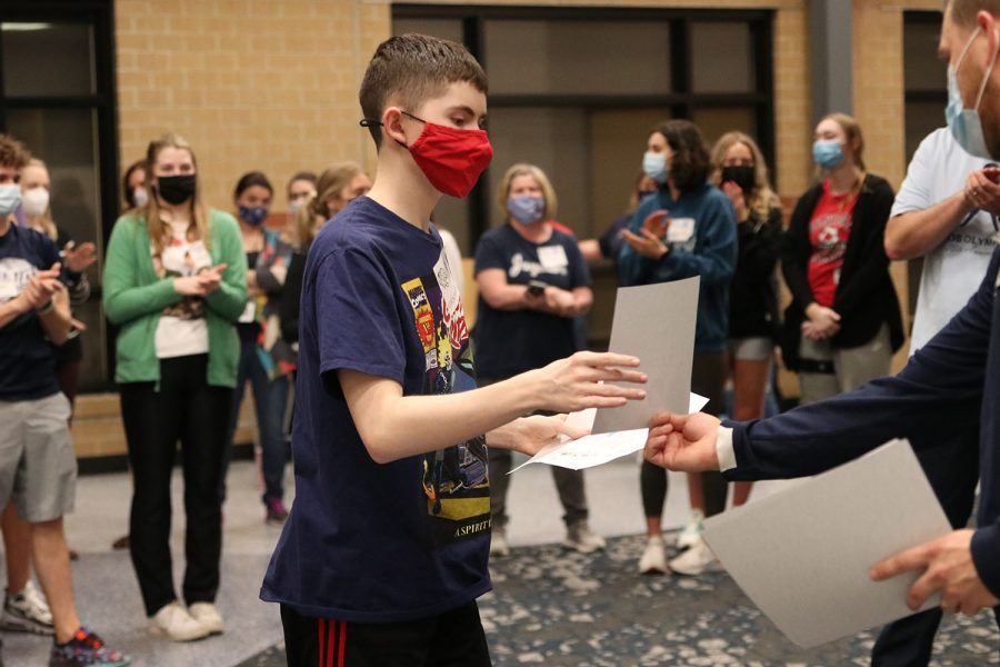 Walking up to collect his letter, senior Aiden Parker receives two placement letters for placing in two separate competitions at the Job Olympics.