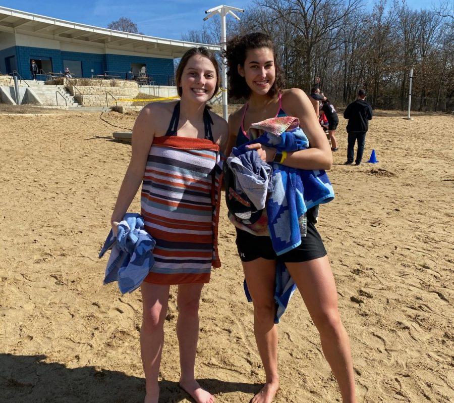 Ready to go, seniors Nicole Crist and Kinley Drummond pose for one more picture before getting into the lake to raise money for the Special Olympics.