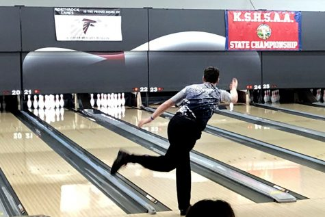 After missing the first shot, senior Jackson Penny hopes to hit all the pins for a spare.