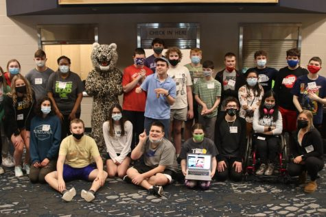After completing the Job Olympics, peers-in-learning students and special education students stand alongside one another to pose for a photo on Tuesday, March 9.