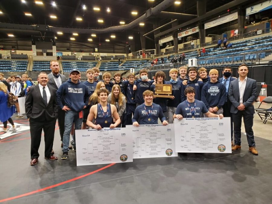 After placing third at the state tournament, the wrestling team poses for a picture
