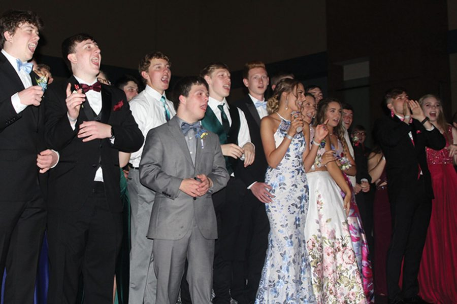Enjoying+the+prom+king+and+queen+dance+on+Saturday%2C+May+4%2C+2019%2C+a+group+of+students+sing+along+to+%22Sweet+Caroline%22.+%22I+thought+%5Bprom%5D+was+more+fun+than+Homecoming.+I+don%27t+really+like+school+dances%2C+but+I+had+a+great+time%2C%22+junior+Nick+Teeple+said.+%22I+think+it+was+because+it+was+only+upperclassmen+and+all+my+friends+are+upperclassmen.%22