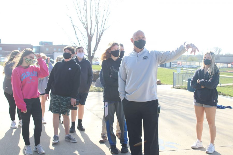 Leading his class, science teacher Eric Thomas takes his zoology class to a new area on Monday, April 5.