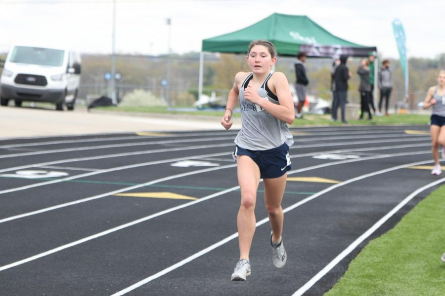 Freshman Kynley Verdict finishes her lap of the 1600 meter run.