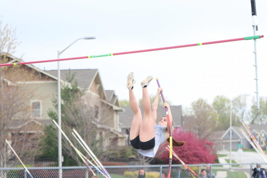 Launching herself in the air, freshman Makenna Payne attempts to clear the rope.