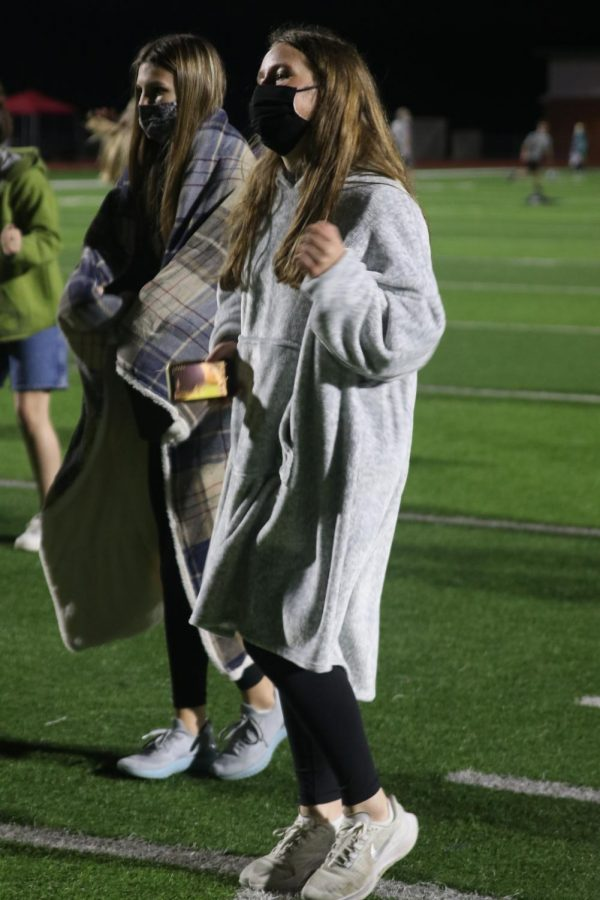 Decked out in a snuggie, freshman Elly VanRheen dances with her friends.