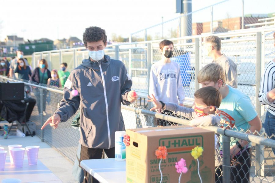 Ping pong ball in hand, sophomore Dylan Ashford watches his customer's throw.
