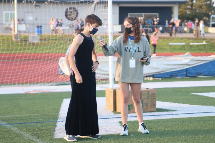 During the Mr. Relay portion of the event, senior Ellie Boone asks sophomore Lucas Robins a question.