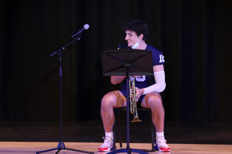 """Trumpet in hand, senior Peter Janssen prepares to give an encore of """"Mary Had a Little Lamb"""" to the audience."""