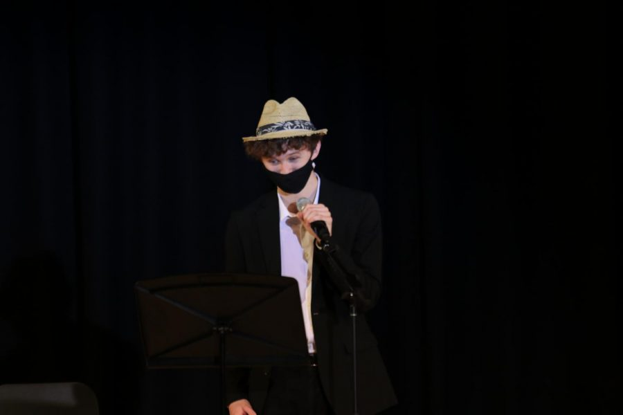 """During the poetry portion of the pageant, senior John Fraka reads the lyrics to Justin Bieber's """"Yummy"""" as his poem."""