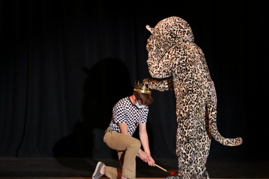 Announced as the winner, junior Nicholas Botkin is crowned as Mr. Mill Valley by J.J. the Jaguar.