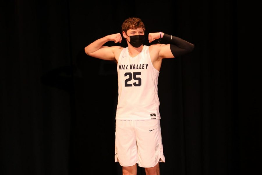 Flexing his muscles, senior Aaron Kephart is introduced as Mr. Basketball.
