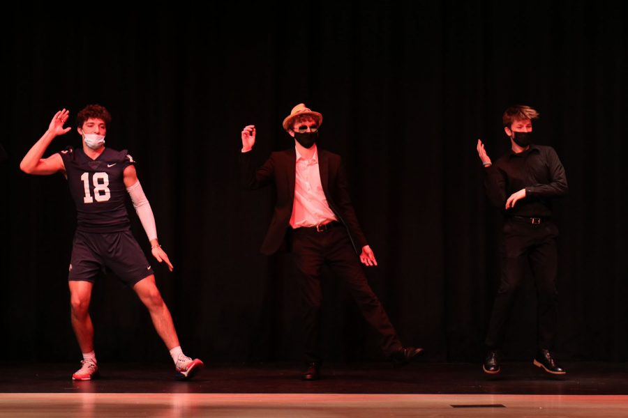 At the beginning of the show, senior John Fraka dances between senior Peter Janssen and junior Fischer Unruh. StuCo held the sixth annual Mr. Mill Valley Friday, April 9 in the Performing Arts Center. Junior Nic Botkin was crowned this year's Mr. Mill Valley after being voted into the final four by the audience, then chosen by the panel of judges to win. The event raised $503 for Relay for Life of Jaguar Nation.