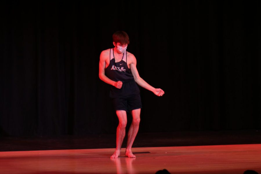 In the middle of his dance, junior Nic Botkin sways from side to side at the front of the stage during Mr. Mill Valley Friday, April 9. Botkin won the title of Mr. Mill Valley.