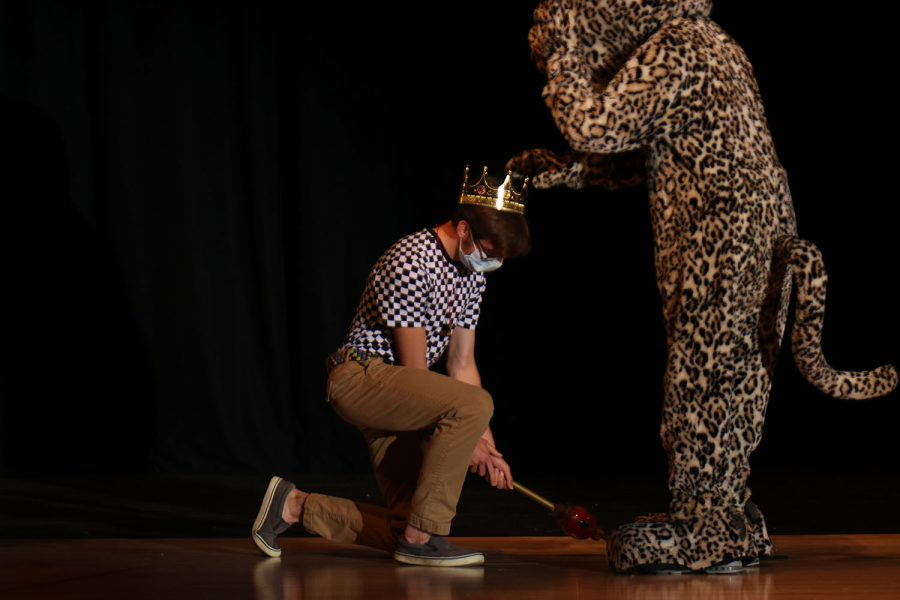 After being announced as this year's Mr. Mill Valley, junior Nicholas Botkin gets crowned by JJ the Jaguar.