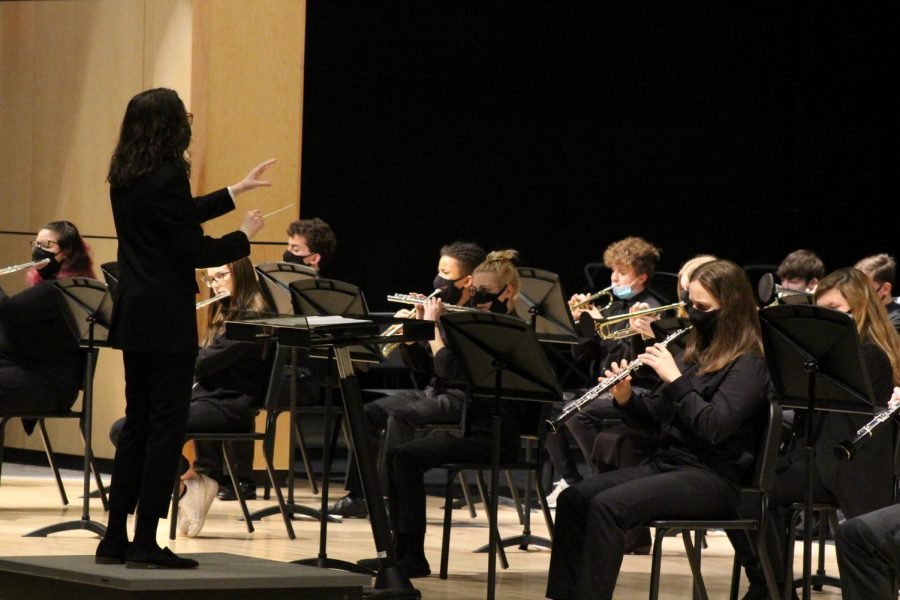 Band teacher Renee Huehy conducts the band through their final performance.