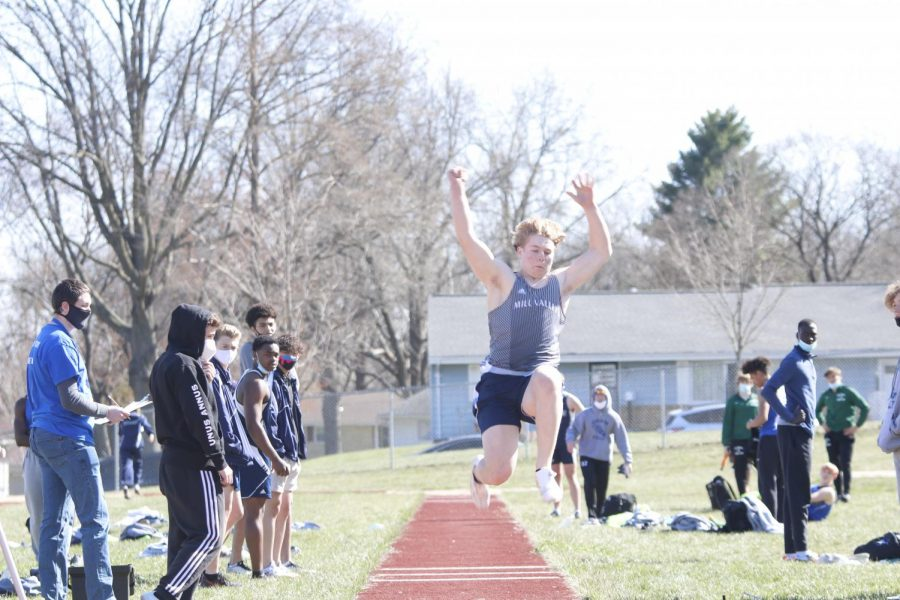 Jumping across the board, sophomore Noah Coy competes in long jump.