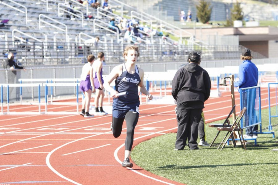 Anchoring for the 4x800m relay, senior Kris Twigg begins his leg of the race. Twigg helped the boys relay team clinch a 1st place finish with a time of 8:33.