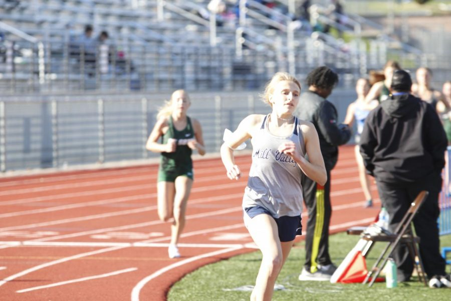 Looking ahead, junior Bridget Roy leads the 1600m race. Roy took 2nd place running a 5:42 PR.