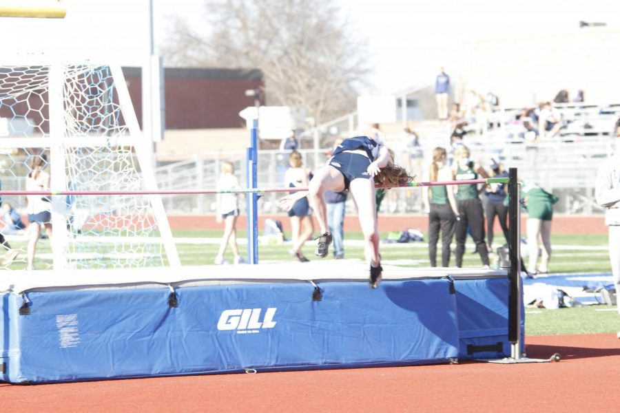 Twisting over the bar, freshman Michelle Marney clears the first round of high jump.