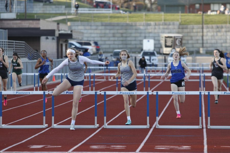 Leading their competitors, juniors Emree Zars and Reese Johnston race the 100m hurdles. Johnston took 2nd place and Zars took 3rd place.
