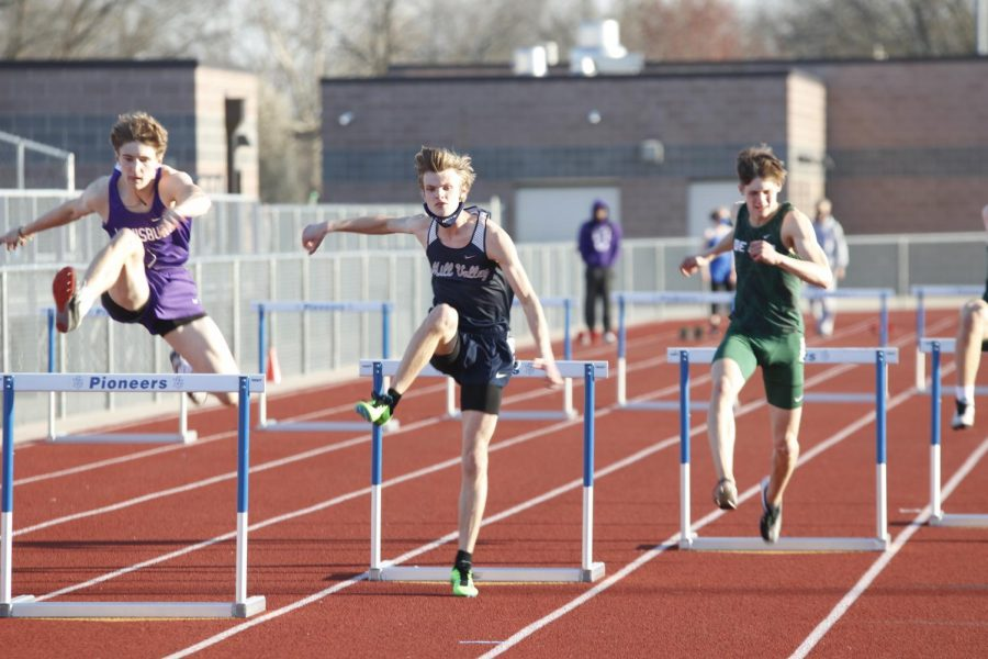 Clearing the second set of hurdles, senior Leif Campbell sprints to the next set placing 3rd in the 300m hurdles.
