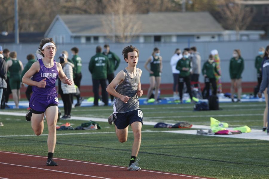 Leading Louisburg High School, sophomore Jack Gilmore maintains his first place spot in the 800m race.