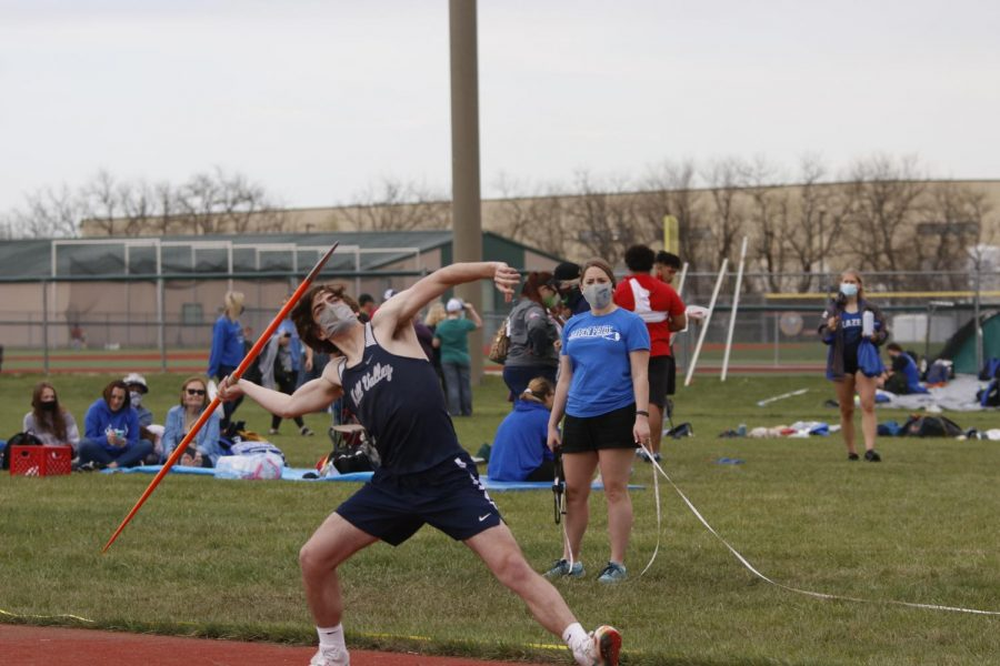 To get a farther distance, senior Dutch Platt angles his body before releasing the javelin.