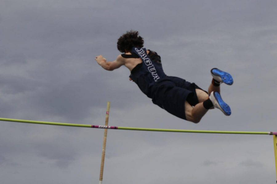 Letting go of the pole, senior Kyle Mayfield clears the rope. Mayfield placed 3rd, clearing 13.06 feet