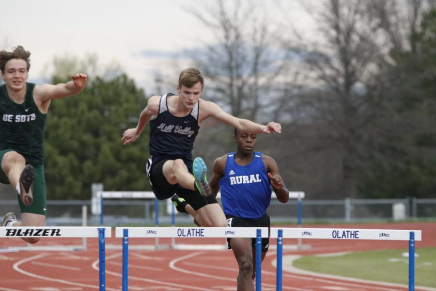 Competing in the 110m hurdles, senior Leif Campbell clears the third set.