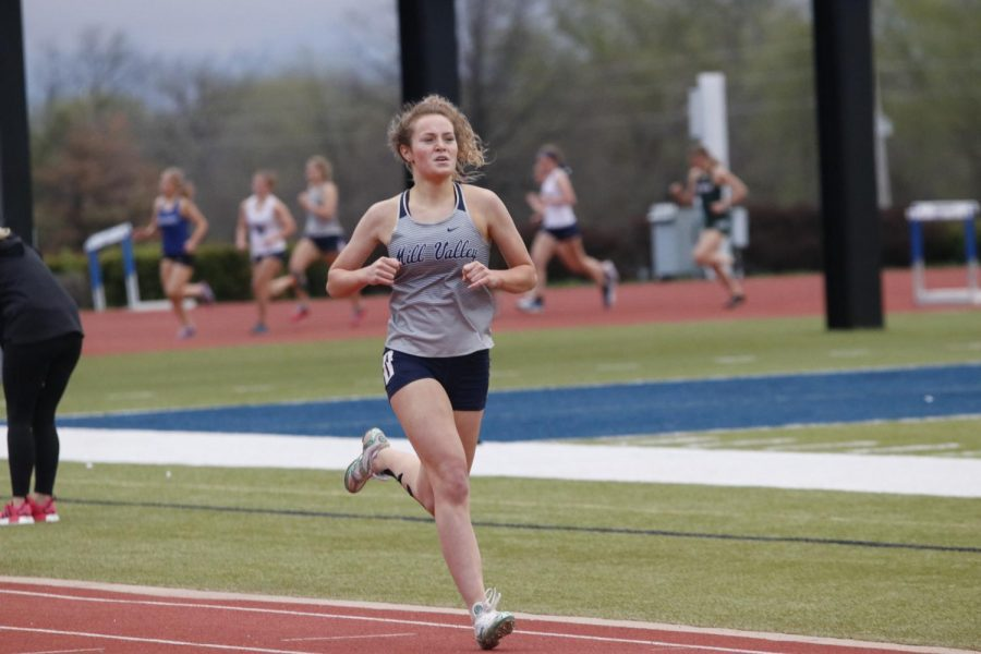 Focusing on the track ahead of her, senior Molly Ricker leads the group of girls in the 800m run. Ricker finished in 2:29 placing 3rd.