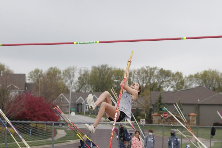 Planting the pole in the box, freshman Ava Fleetwood prepares to vault herself over the rope. Fleetwood tied for 8th place clearing an impressive heigh of 8-6.
